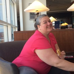Photo taken at Delta Sky Club by James P. on 5/28/2015