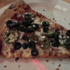 Photo taken at The Roman Candle Pizzeria by Dan S. on 10/12/2012
