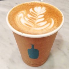 Photo taken at Blue Bottle Coffee by Tina W. on 7/28/2013