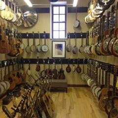 Photo taken at Gruhn Guitars by Thomas S. on 5/13/2013