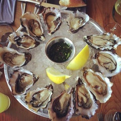 Photo taken at Hog Island Oyster Co. by Lana C. on 6/1/2013