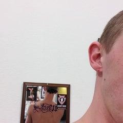 Photo taken at Blue Lotus Tattoo by Jenen W. on 1/6/2013