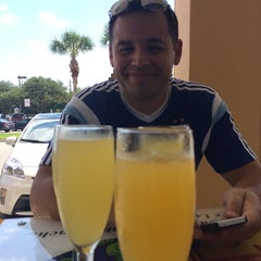 Photo taken at Sea Oats Cafe by Angel O. on 8/9/2014