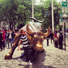 Photo taken at Charging Bull by Tim L. on 5/26/2013