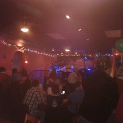 Photo taken at Tall Gary's by Laura H. on 1/1/2013