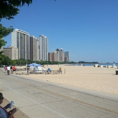 Photo taken at Oak Street Beach by Kyle B. on 7/19/2013