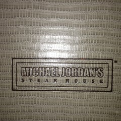 Photo taken at Michael Jordan's Steak House Chicago by Sam E. on 2/15/2013