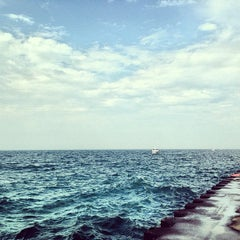 Photo taken at St. Joseph South Pier (at Silver Beach) by Alyssa G. on 9/7/2013