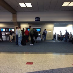 Photo taken at Gate B12 by Tracey C. on 11/15/2013