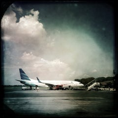 Photo taken at Ahmad Yani International Airport (SRG) by roni a. on 5/6/2013