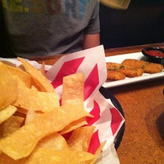 Photo taken at TGI Fridays by Alison M. on 7/27/2013