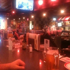Photo taken at Ninety Nine Restaurant by Claudia M. on 9/24/2011