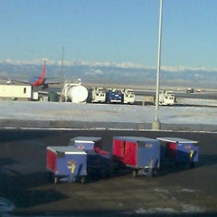 Photo taken at Gate C28 by Heather H. on 12/10/2011