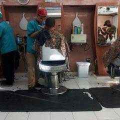 Photo taken at Dominguez Barbershop by Jose M. on 11/16/2012