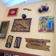 Photo taken at La Tinajita Pizzeria by Carlos C. on 8/15/2014
