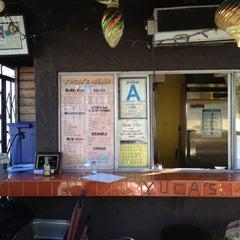 Photo taken at Yuca's Taqueria by Teresa B. on 10/15/2012