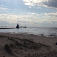 Photo taken at St. Joseph North Pier (at Tiscornia Park) by Sharon Z. on 5/3/2014