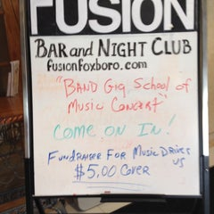 Photo taken at Fusion Bar & Night Club by Jessica H. on 1/27/2014