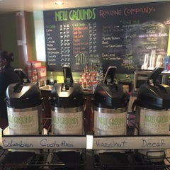 Photo taken at New Grounds Roasting Company by T S. on 8/31/2015