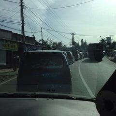 Photo taken at Jalan Raya Puncak by 'Iway O. on 12/29/2013
