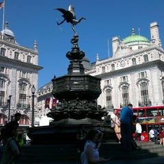 Photo taken at Piccadilly Circus by Tomass K. on 7/19/2013