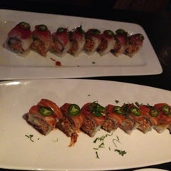 Photo taken at Sushi Axiom by brittany h. on 12/18/2012