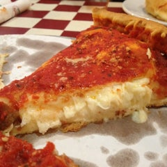 Photo taken at Giordano's by Alejandro E. on 11/1/2012