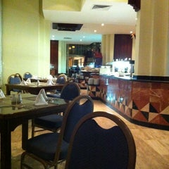 Photo taken at Café Quetzal by Carola A. on 10/16/2012