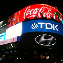 Photo taken at Piccadilly Circus by Akos S. on 12/1/2012