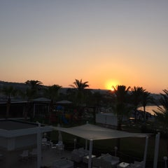 Photo taken at Okeanos Beach Hotel by Anton S. on 7/25/2015