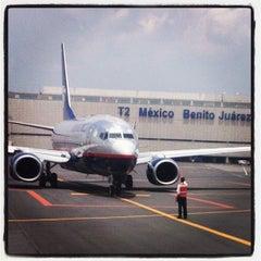 Photo taken at Aeropuerto Internacional de la Ciudad de México (MEX) by Corpus M. on 7/15/2013