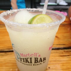 Photo taken at Martell's Tiki Bar by Letty R. on 6/17/2013