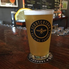 Photo taken at Scratchtown Brewing Company by Sara S. on 8/1/2015