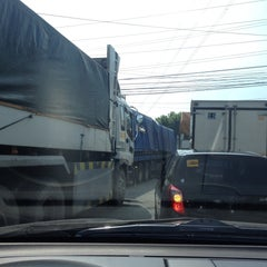 Photo taken at NLEx Bocaue Toll Plaza by Pau on 10/23/2015