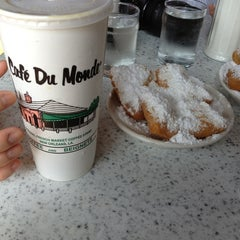 Photo taken at Café du Monde by Josh W. on 5/24/2013