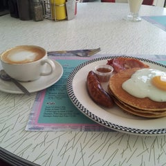 Photo taken at Woodies Longboard Diner by Mark I. on 9/29/2012