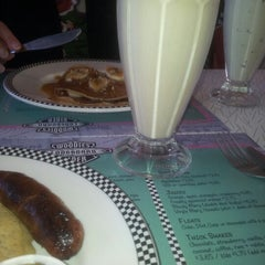Photo taken at Woodies Longboard Diner by Mark I. on 12/1/2012