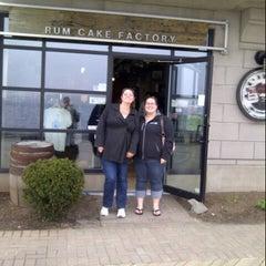 Photo taken at Rum Runners - Rum Cake Factory by Jennifer K. on 5/11/2013