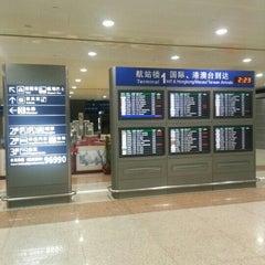 Photo taken at 上海浦东国际机场1号航站楼 T1 Shanghai Pudong Int'l Airport by Teeradech U. on 9/29/2012