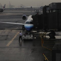 Photo taken at Gate A26 by Red D. on 10/4/2012