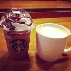 Photo taken at Starbucks Coffee 茅場町店 by Miku M. on 5/21/2013