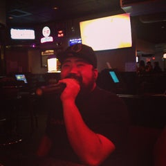 Photo taken at Karaoke Hut Sports Bar & Grill by Jennifer L. on 7/28/2013