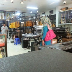 Photo taken at Cresendo music shop & music school by Raditsya M. on 3/31/2014