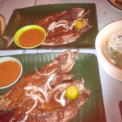 Photo taken at Medan Ikan Bakar Sungai Merab by Nur F. on 10/21/2012