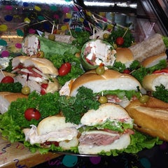 Photo taken at Melissa's Gourmet Deli by Amy S. on 12/10/2013