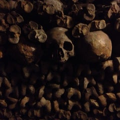 Photo taken at Catacombes de Paris by Ian F. on 5/10/2013