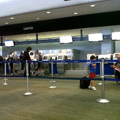 Photo taken at United International Check In by Nicolay A. on 10/6/2012