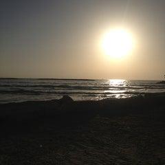 Photo taken at Frishman Beach (חוף פרישמן) by Mijael S. on 2/9/2013