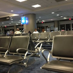 Photo taken at Gate D60 by Vitor M. on 4/27/2013