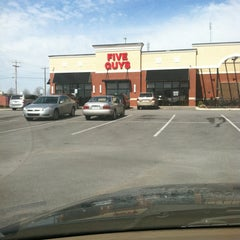 Photo taken at Five Guys by Bishop A. on 3/4/2013
